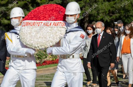 Turkey's main opposition Republican People's Party leader Kemal Kilicdaroglu, right, and newly elected executive committee members wearing face masks to protect against the spread of coronavirus, follow a military honour guard as they visit the mausoleum of modern Turkey's founder Mustafa Kemal Ataturk, in Ankara, Turkey