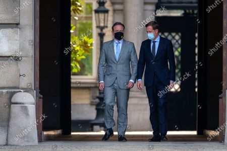N-VA chairman Bart De Wever and PS chairman Paul Magnette leave after a meeting with the King at the Royal Palace in Brussels, Saturday 08 August 2020, regarding the formation of a new government after the federal elections of 26 May 2019.
