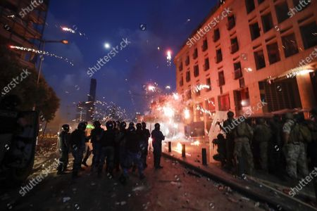 People clash with police during a protest against the political elites and the government after this week's deadly explosion at Beirut port which devastated large parts of the capital and killed more than 150 people, in Beirut, Lebanon