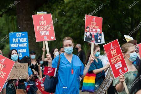 NHS staff gather in St James's Park ahead of a protest march to Parliament Square through central London to demand 15% pay rise for NHS workers. Protesters demonstrate against not being included in the government's pay deal for 900,000 public sector workers amid the sacrifices and hardship experienced during the coronavirus pandemic.