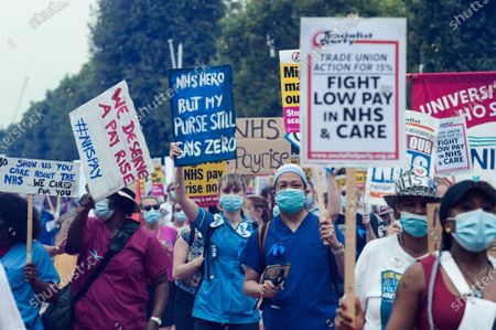 NHS staff take part in a protest march from St James's Park to Parliament Square through central London to demand 15% pay rise for NHS workers. Protesters demonstrate against not being included in the government's pay deal for 900,000 public sector workers amid the sacrifices and hardship experienced during the coronavirus pandemic.