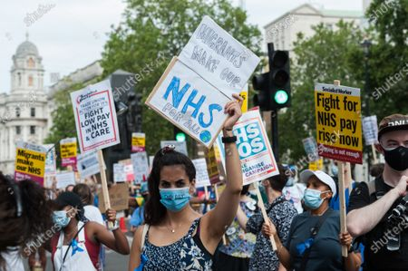 NHS staff demonstrate outside Downing Street during a protest march from St James's Park to Parliament Square through central London to demand 15% pay rise for NHS workers. Protesters demonstrate against not being included in the government's pay deal for 900,000 public sector workers amid the sacrifices and hardship experienced during the coronavirus pandemic.