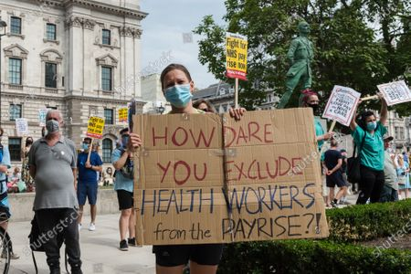 NHS staff take part in a rally in Parliament Square after marching through central London to demand 15% pay rise for NHS workers. Protesters demonstrate against not being included in the government's pay deal for 900,000 public sector workers amid the sacrifices and hardship experienced during the coronavirus pandemic.