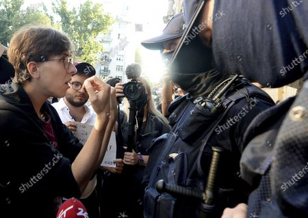 Activist Malgorzata Szutowicz, left, known as Margot, confronts police before being arrested in Warsaw, Poland, on . LGBT rights activists scuffled with police Friday in Warsaw after turning out on the streets to protest the arrest of an an activist. According to Polish media reports, the activist was placed under two-months arrest Friday for protest actions against anti-homosexual attitudes. After the person was arrested in central Warsaw, protesters surrounded the police car and one person climbed on top of it