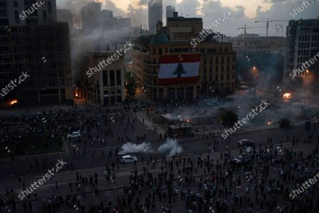 People clash with police during a protest against the political elites and the government after this week's deadly explosion at Beirut port which devastated large parts of the capital in Beirut, Lebanon