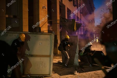 People clash with police during a protest against the political elites and the government after this week's deadly explosion at Beirut port which devastated large parts of the capital, in Beirut, Lebanon