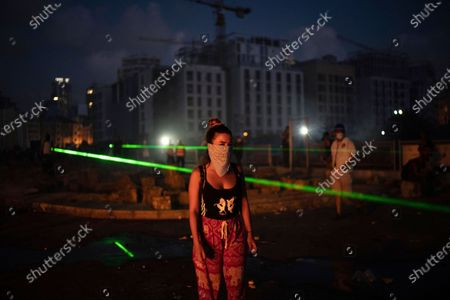 Woman looks on during a protest against the political elites and the government after this week's deadly explosion at Beirut port which devastated large parts of the capital, in Beirut, Lebanon