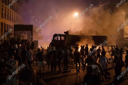 Demonstrators clash with police during a protest against the political elites and the government after this week's deadly explosion at Beirut port which devastated large parts of the capital in Beirut, Lebanon