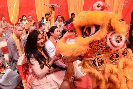Film Actress Rituparna Sengupta takes orange from artist of Lion dance during lion dance on the occasion of 50th anniversary of Hsuan Tsang monastery. Chinese people celebrates 50th anniversary of Hsuan Tsang monastery the only Chinese Buddhist temple in Kolkata. The Hsuan Tsang monastery built in 1968 and named after the famous Chinese Buddhist monk and traveler Hsuan Tsang who came to India about 1400 years ago.