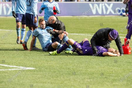 Jonathan Spector (2) of Orlando City SC and Maxime Chanot (4) of NYC FC assisted by medical staff after collision during regular MLS game at Yankee stadium NYC FC won 2 - 0