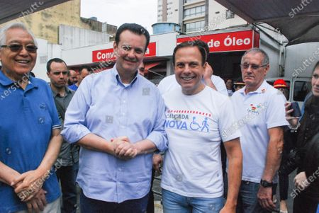 Stock Image of Mayor of Sao Paulo city-Joao Doria (in white T.Shirt) with Gilberto kassab (in Blue shirt) Brazilian Minister of Science,Technology,Innovations & Communications during Brooklinfest-German festival