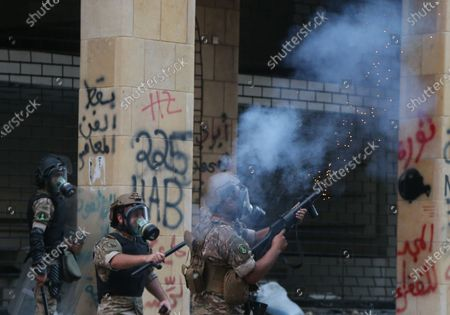 Lebanese security forces fire tear gas canisters during clashes with anti-government protesters at a protest in Beirut, Lebanon, 08 August 2020. People gathered for the so-called 'the Saturday of the hanging ropes' to protest against the political leaders and calling on those responsible over the explosion to be held accountable. Lebanese Health Ministry on 07 August said at least 154 people were killed, and more than 5,000 injured in the Beirut blast that devastated the port area on 04 August and believed to have been caused by an estimated 2,750 tons of ammonium nitrate stored in a warehouse.