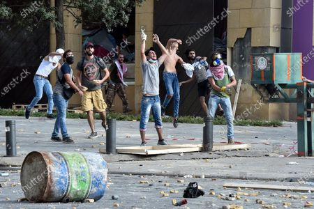 Anti-government protesters clash with Lebanese riot police during a protest outside of the Lebanese Parliament in Beirut, Lebanon, 08 August 2020. People gathered for the so-called 'the Saturday of the hanging ropes' to protest against the political leaders and calling on those responsible over the explosion to be held accountable. Lebanese Health Ministry on 07 August said at least 154 people were killed, and more than 5,000 injured in the Beirut blast that devastated the port area on 04 August and believed to have been caused by an estimated 2,750 tons of ammonium nitrate stored in a warehouse.
