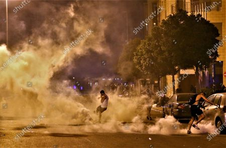 Anti-government protesters walk among tear gas during anti-government protests in Beirut, Lebanon, 08 August 2020. People gathered for the so-called 'the Saturday of the hanging ropes' to protest against the political leaders and calling on those responsible over the explosion to be held accountable. Lebanese Health Ministry on 07 August said at least 154 people were killed, and more than 5,000 injured in the Beirut blast that devastated the port area on 04 August and believed to have been caused by an estimated 2,750 tons of ammonium nitrate stored in a warehouse.