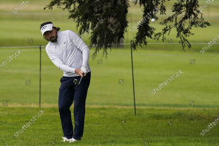 Mike Lorenzo-Vera, of France, hits from the rough on the second hole during the third round of the PGA Championship golf tournament at TPC Harding Park, in San Francisco
