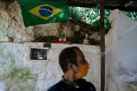 Bust representing Anastacia, an enslaved African woman venerated by devotees of the Umbanda religion, is displayed in a niche in a wall in the home of 25-year-old Hugo do Nascimento who died from the new coronavirus, in Rio de Janeiro, Brazil, . Brazil was leaping toward a grim milestone, 100,000 deaths from COVID-19, on Saturday, Aug. 8, and five months after the first reported case, the country had not shown signs of crushing the disease