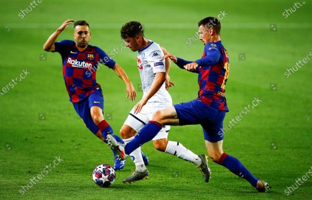 FC Barcelona's Jordi Alba (L) and Clement Lenglet (R) in action against SCC Napoli's Diego Demme (C) during the UEFA Champions League round of 16 second leg soccer match between FC Barcelona and SCC Napoli in Barcelona, Catalonia, north eastern Spain, 08 August 2020.