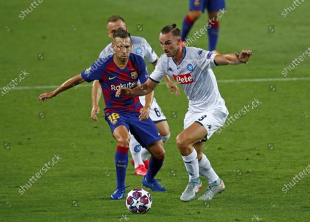 Napoli's Fabian Ruiz, right, holds off Barcelona's Jordi Alba during the Champions League round of 16, second leg soccer match between Barcelona and Napoli at the Camp Nou Stadium in Barcelona, Spain