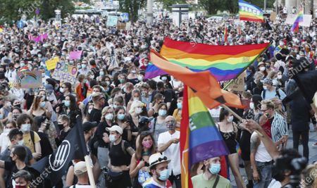 Rights supporters protest in Warsaw, Poland, . A large crowd of LGBT rights supporters gathered in Warsaw on Saturday to protest the arrest of a transgender activist who had carried out acts of civil disobedience against rising homophobia in Poland