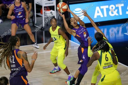 Phoenix Mercury's Skylar Diggins-Smith (4) looks to pass to teammate Brittney Griner (42) as Seattle Storm's Natasha Howard defends during the first half of a WNBA basketball game, in Bradenton, Fla