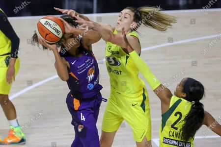 Stock Photo of Phoenix Mercury's Skylar Diggins-Smith, left, is defended by Seattle Storm's Breanna Stewart, center, and Jordin Canada, right, during the first half of a WNBA basketball game, in Bradenton, Fla