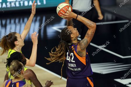 Phoenix Mercury's Brittney Griner, right, shoots against the defense of Seattle Storm's Breanna Stewart, center, during the first half of a WNBA basketball game, in Bradenton, Fla
