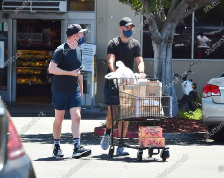 Stock Photo of Jesse Tyler Ferguson and Justin Mikita are seen leaving the grocery store