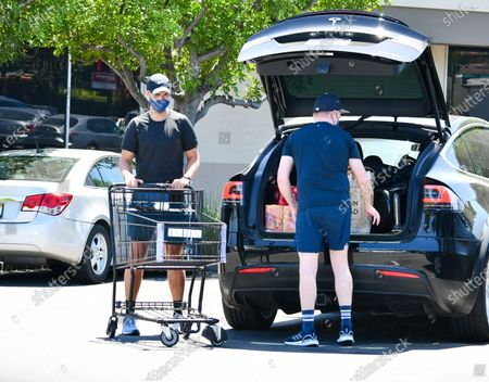 Jesse Tyler Ferguson and Justin Mikita are seen leaving the grocery store