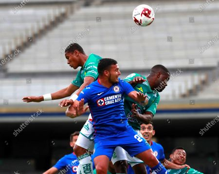 Stock Photo of Juan Escobar (front) of Cruz Azul in action against Joel Campbell (R) of Leon during the 2020 Apertura Tournament soccer match at the Olimpico Universitario Stadium in Mexico City, Mexico, 08 August 2020.