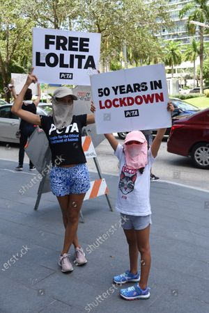"Stock Image of Protesters. 50 Years to the Day: 'Orca' in a fishbowl shames Anniversary of Lolita's Capture. PETA Supporters - including model and online influencer Natasha Araos and actor and Miss Universe 1996 Alicia Machado, and accompanied by a giant inflatable orca trapped in a fishbowl and holding ""Free Lolita!"" signs.50 Years to the Day: 'Orca' in a fishbowl shames Anniversary of Lolita's Capture. PETA Supporters - including model and online influencer Natasha Araos and actor and Miss Universe 1996 Alicia Machado, and accompanied by a giant inflatable orca trapped in a fishbowl and holding ""Free Lolita!"" signs."