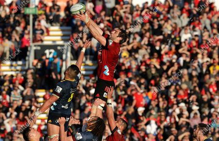 Crusaders Samuel Whitelock reaches for the ball to win a line out during the Super Rugby Aotearoa rugby game between the Crusaders and the Highlanders in Christchurch, New Zealand