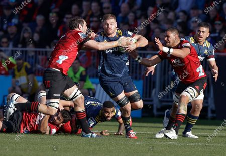 Highlanders Jack Whetton runs at Crusaders Samuel Whitelock, left, and Whetukamokamo Douglas, right, during the Super Rugby Aotearoa rugby game between the Crusaders and the Highlanders in Christchurch, New Zealand