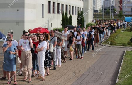 Belarusian people queue outside a polling station to cast their votes during the presidential elections in Minsk, Belarus, 09 August 2020. Five candidates are contesting for the presidential seat, including the incumbent President Lukashenko.