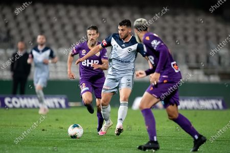 Stock Image of Melbourne Victory forward Andrew Nabbout (9) controls the ball