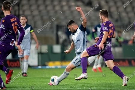 Stock Photo of Melbourne Victory forward Andrew Nabbout (9) kicks the ball