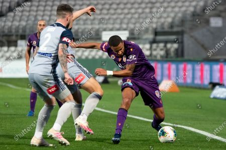 Perth Glory defender James Meredith (8) controls the ball