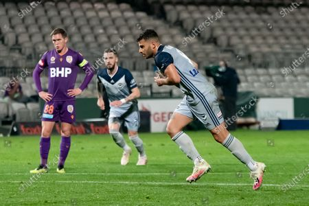 Melbourne Victory forward Andrew Nabbout (9) runs into strike a penalty shot