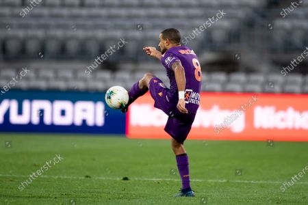 Stock Image of Perth Glory defender James Meredith (8) controls the ball