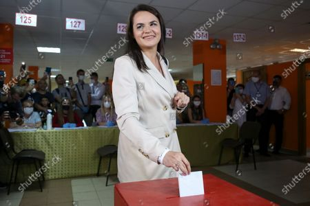 Sviatlana Tsikhanouskaya, candidate for the presidential elections, poses for a photo as she casts her ballot at a polling station during the presidential election in Minsk, Belarus, . Belarusians are voting on whether to grant incumbent president Alexander Lukashenko a sixth term in office, extending his 26-years rule, following a campaign marked by unusually strong demonstrations by opposition supporters