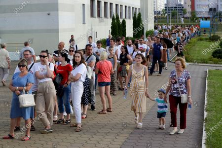 People queue to cast their votes in the Belarusian presidential election in Minsk, Belarus, . Belarusians are voting on whether to grant incumbent president Alexander Lukashenko a sixth term in office, extending his 26-years rule, following a campaign marked by unusually strong demonstrations by opposition supporters