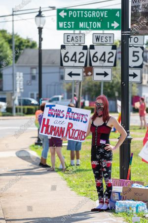 """Ashley Johnson, of Sunbury, holds a sign reading """"trans rights are human rights"""" during theMilton Pride Rally. The I Am Alliance organized the event to show support for the LGBTQ community."""