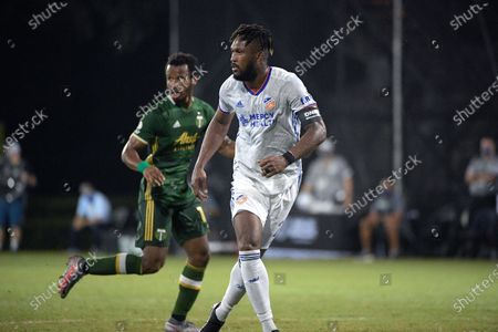 Stock Photo of Cincinnati defender Kendall Waston, right, and Portland Timbers forward Jeremy Ebobisse follow a play during the second half of an MLS soccer match, in Kissimmee, Fla