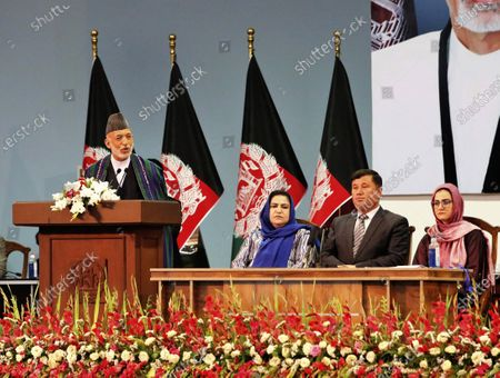 Former Afghan President Hamid Karzai, left, speaks on the last day of an Afghan Loya Jirga or traditional council, in Kabul, Afghanistan, . The council concluded Sunday with hundreds of delegates agreeing to free 400 Taliban members, paving the way for an early start to negotiations between Afghanistan's warring sides
