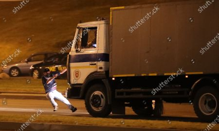 A police truck hits an opposition activist during a protest after polling stations closed at the presidential elections in Minsk, Belarus, 09 August 2020. Five candidates are contesting for the presidential seat, including the incumbent president Lukashenko.