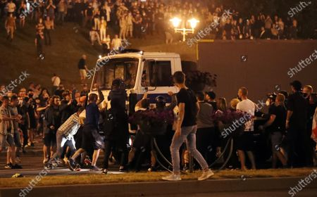 A police truck, carrying demonstrators, makes its way through a crowd of opposition protesters after polling stations closed at the presidential elections in Minsk, Belarus, 09 August 2020. Five candidates are contesting for the presidential seat, including the incumbent president Lukashenko.