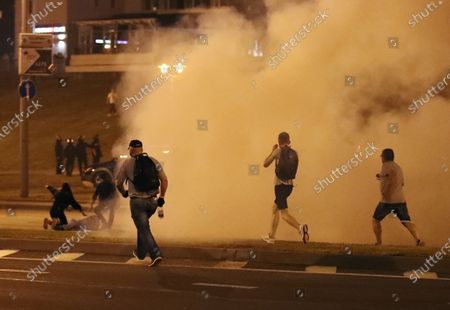 Opposition protesters help a protesters who was hit while trying to stop a police vehicle after polling stations closed at the presidential elections in Minsk, Belarus, 09 August 2020. Five candidates are contesting for the presidential seat, including the incumbent president Lukashenko.