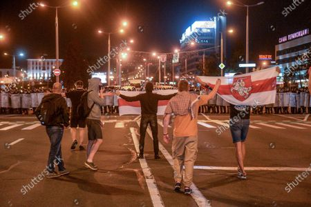 Opposition supporters face off with police during a protest after polling stations closed at the presidential elections in Minsk, Belarus, 09 August 2020. Five candidates are contesting for the presidential seat, including the incumbent president Lukashenko.