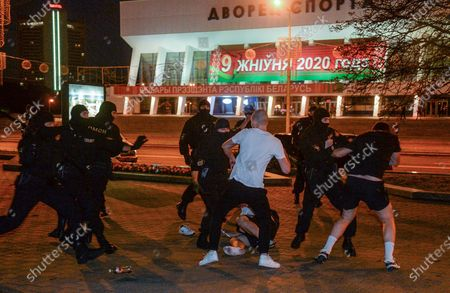 Opposition supporters clash with police during a protest after polling stations closed at the presidential elections in Minsk, Belarus, 09 August 2020. Five candidates are contesting for the presidential seat, including the incumbent president Lukashenko.
