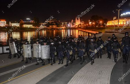Policemen advance along a street during a protest after polling stations closed at the presidential elections in Minsk, Belarus, 09 August 2020. Five candidates are contesting for the presidential seat, including the incumbent president Lukashenko.