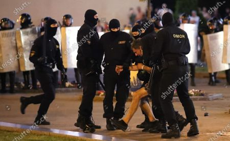 Riot police detain a demonstrator during a protest after polling stations closed in the presidential elections, in Minsk, Belarus, 09 August 2020. Five candidates are contesting for the presidential seat, including the incumbent president Lukashenko.